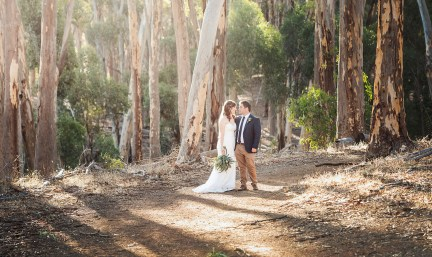 bride and groom standing in the Belair National park