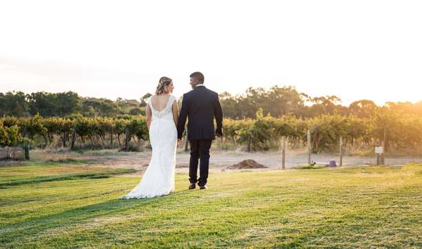 bride and groom walking into Ekhidna winery vineyards