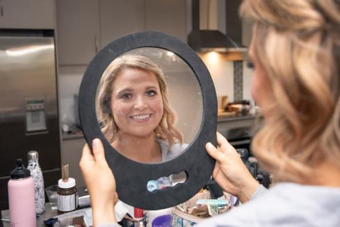 bride looking at mirror