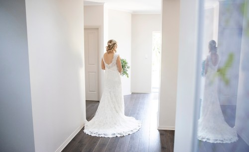 Bride walking out front door