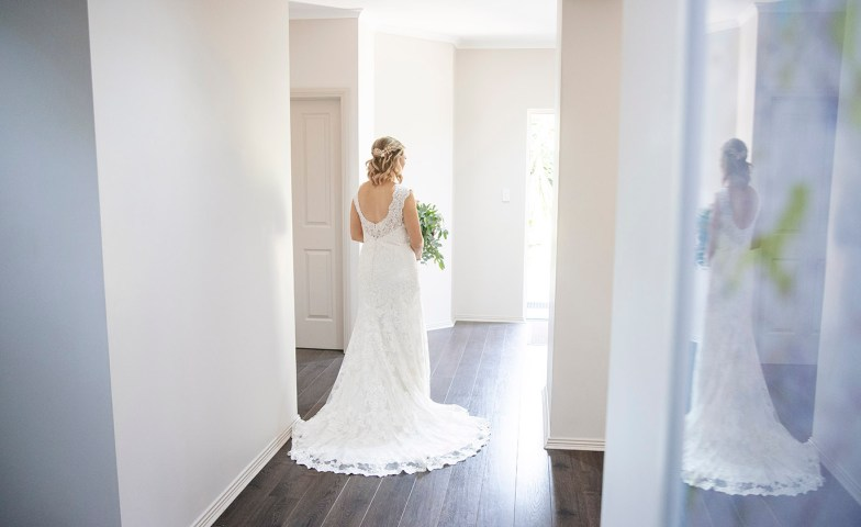 Bride walking out front door