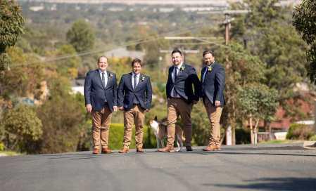 Groom and groomsmen on road