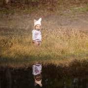 Little girl on waters edge