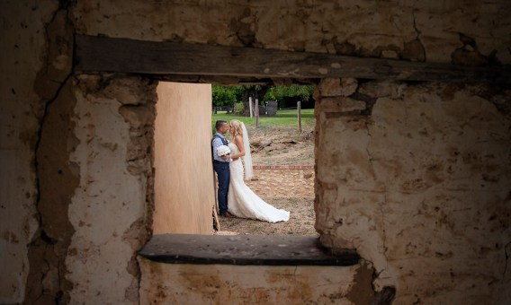Bride and groom through the window