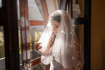 Bride looking out window at Thorngrove Manor