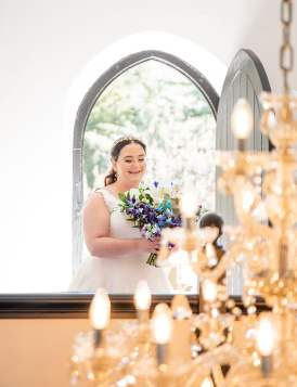bride overlooking chandelier