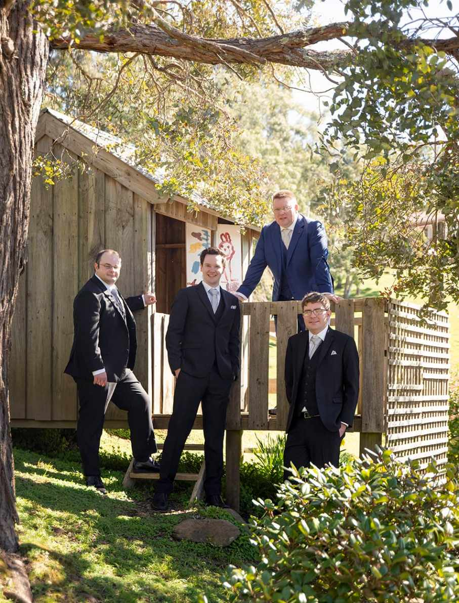 Groom and groomsmen in cubby house 2