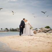 Sharing a kiss under seagulls