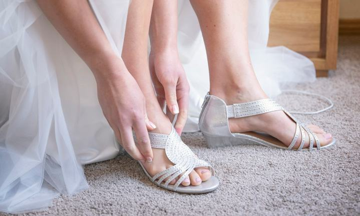 Putting on bridal shoes