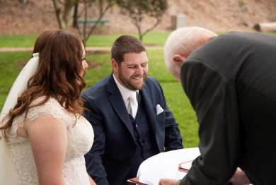 Smiling groom while signing register