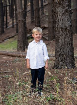 Smiling boy amongst the trees