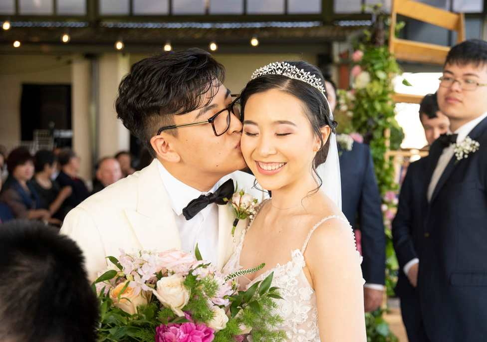 Kiss on the cheek from groom