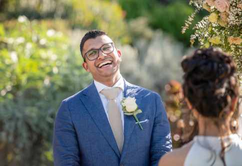 laughing groom during ceremony 2