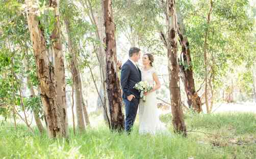 Bridal couple amongst the trees at Serafino WInes