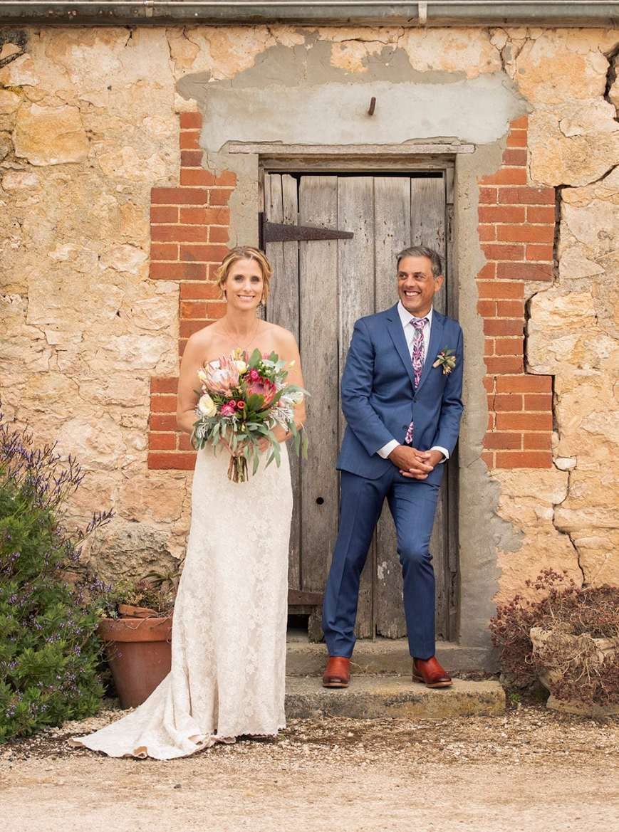 Bride and groom in doorway at Crabtree farm
