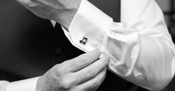 close up of cufflinks on shirt