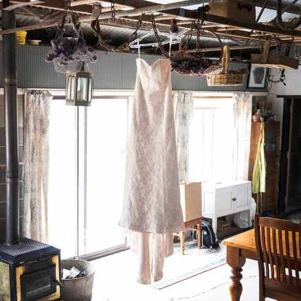 Hanging wedding dress in shed
