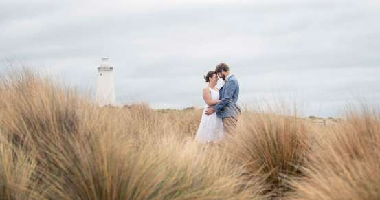Bride and groom in front of Cape Willoughby Lighthouse