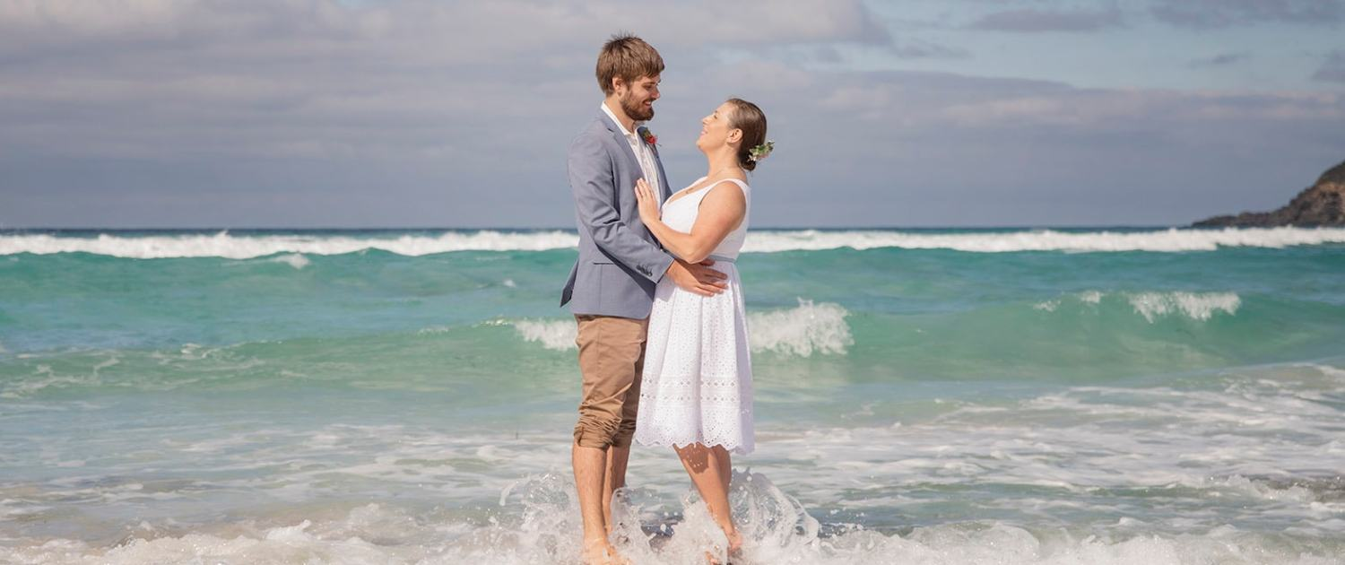 bride and groom on a rock