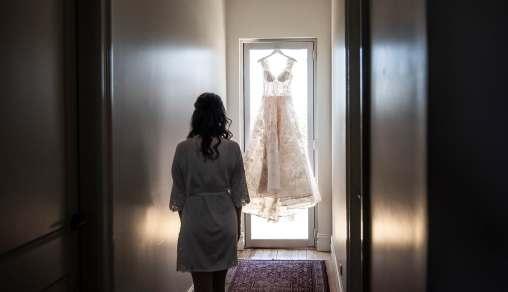 Bride walking towards her wedding dress