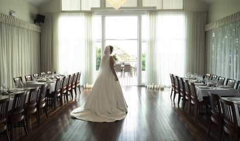 Bride looking pretty in the watershed wedding reception area