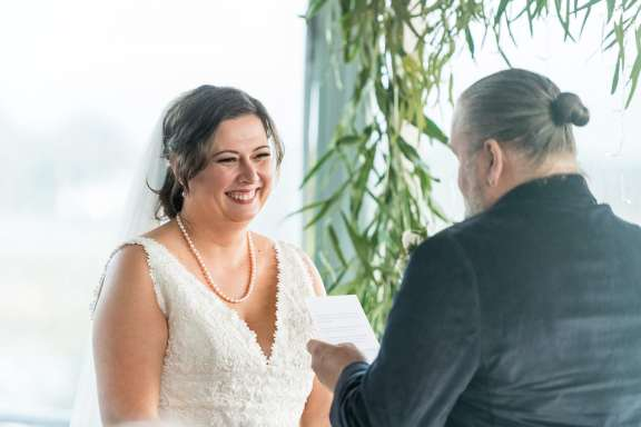 Smiling bride as she listens to vows