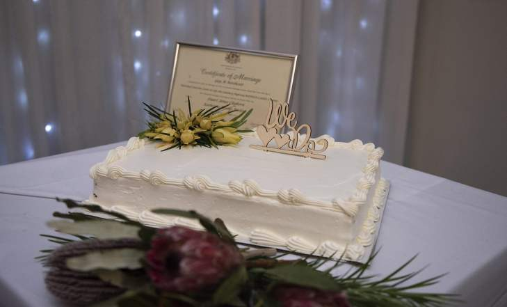 Wedding Cake on display with Certificate