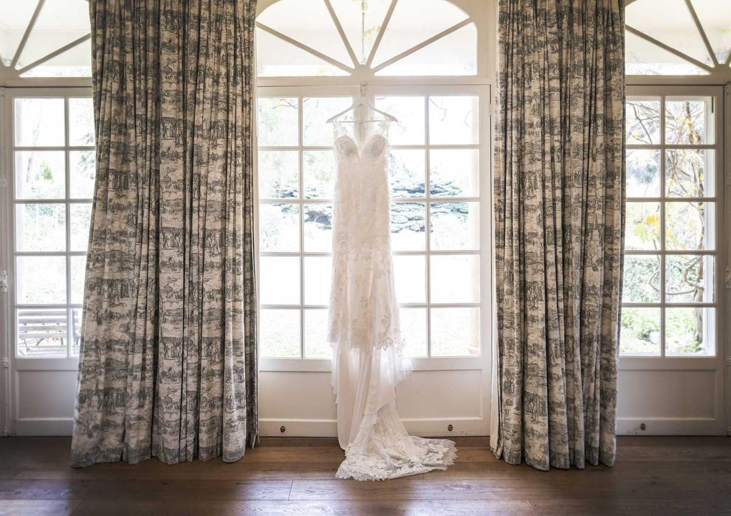 Wedding dress hanging At Alru Farm wedding