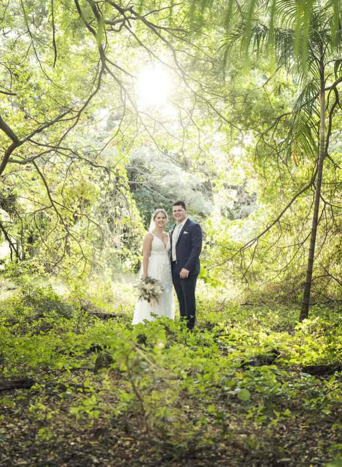 Bride and groom amongst the green trees