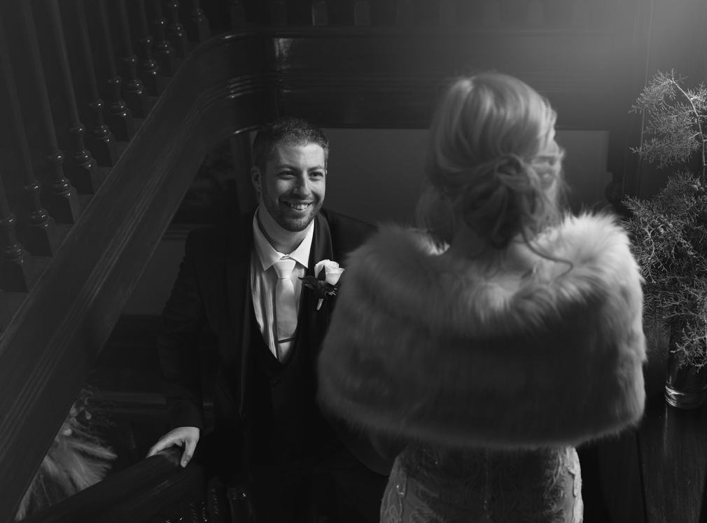 Groom smiling at bride in Mount Lofty House