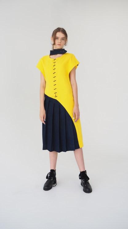 women denim midi design dress yellow and dark blue pleated bottom metal lase front golden details fashion desigh collar front