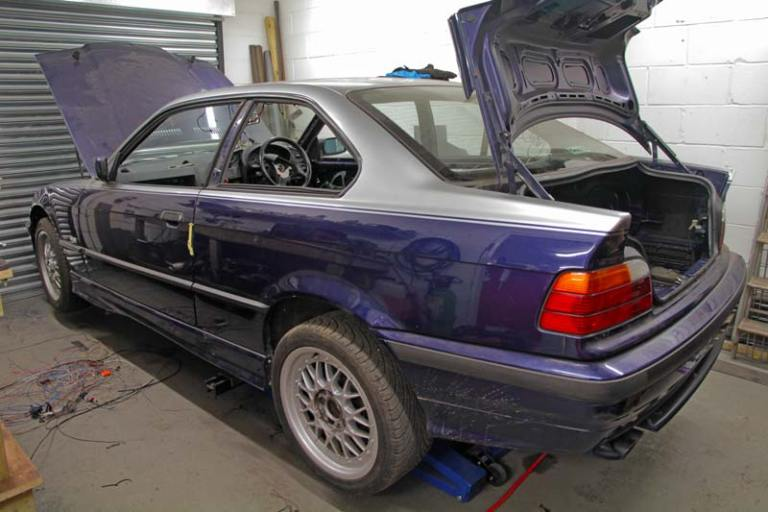 BMW E36 328 Coupe being prepared for racing