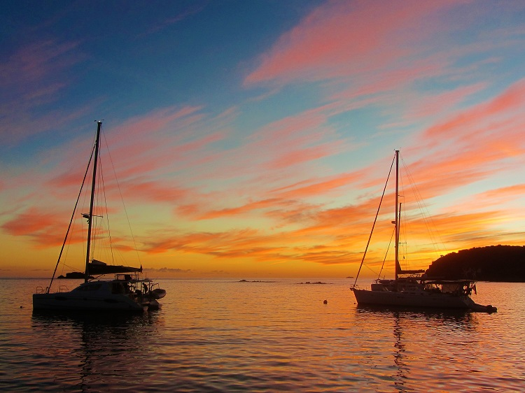 Sunset With Two Boats