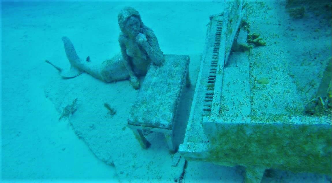 Mermaid and piano