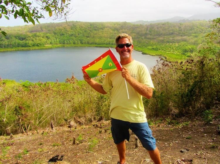 Holding the Grenada flag