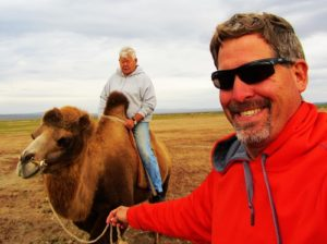 Leading my dad on a camel