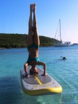 Head stands on a SUP
