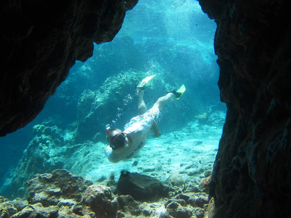 Snorkeling through a tunnel