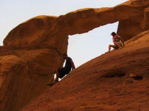 Climbing rocks in Wadi Rum Jordan