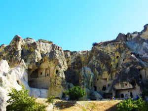 "The Goreme Open Air Museum is a valley in the Cappadocia area of Turkey (next to a city of the same name). It contains the remains of a Christian society escaping persecution from the Roman Empire during the 1st through 3rd centuries. There must be a dozen churches in the open air museum and that is not including the convent, monk dorms, kitchens, and other support buildings. Of course in true Cappadocian style, all of these buildings are actually carved into the soft rock in the canyon.  The best part about this location outside of the amazing feat of having the buildings carved into the rock is that many of the churches contain fantastically preserved fresco painting on the walls and ceilings. These frescos are within the numerous churches and we spent 20 minutes alone in the ""Dark"" church admiring each piece of religious artwork. The entire interior of the church is covered, so each scene works by itself and joins the rest to tell the biblical story. Because of these well-preserved churches and other buildings carved into the rock, this entire site was placed on the World Heritage List in 1985. It is one of the must-see places in the Cappadocia area and helps put all the rock carved building into your grasp as you explore each and every one of them. #passportready #instatravel #travel #travelblogger #wanderlust #aroundtheworld #instapassport #instalike #livingthedream #inspire #beautiful #lifestyle #ilovetravel #adventure #memories #explore #amazingview #mustsee #lovetotravel #history #travelblog #cappadocia #turkey #monastery #goreme"