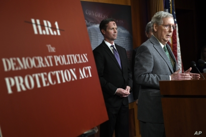 Senate Majority Leader Mitch McConnell of Ky., right, speaks during a news conference on Capitol Hill in Washington, Wednesday,…