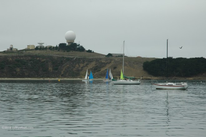 Half Moon Bay is easy to find.  The Air Force radar domes on Pillar Point are visible from miles away.