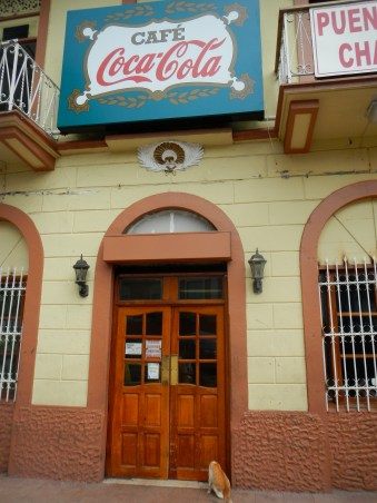 Oldest cafe in Panama City (Est. 1875) Classic rice and beans and excellent coffee. That cat slipped in the door right after I took this photo.