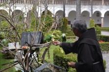 Monk feeding his birds in San Francisco Monastery