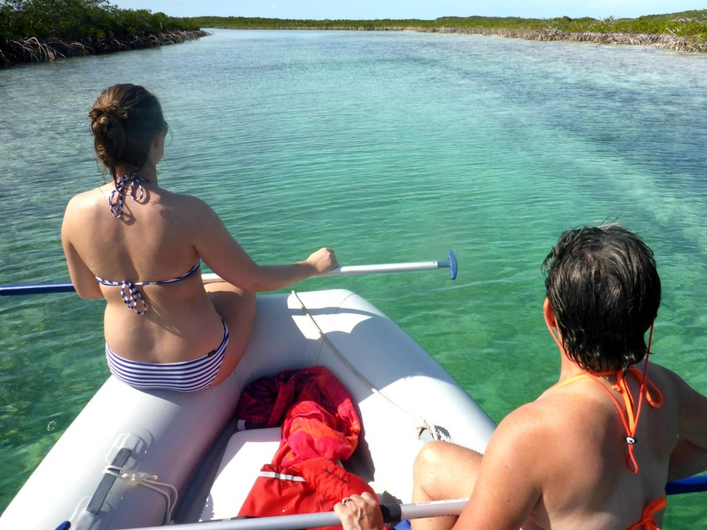 Lindsay and Gail watching for sandbars and rocks on the dinghy ride back