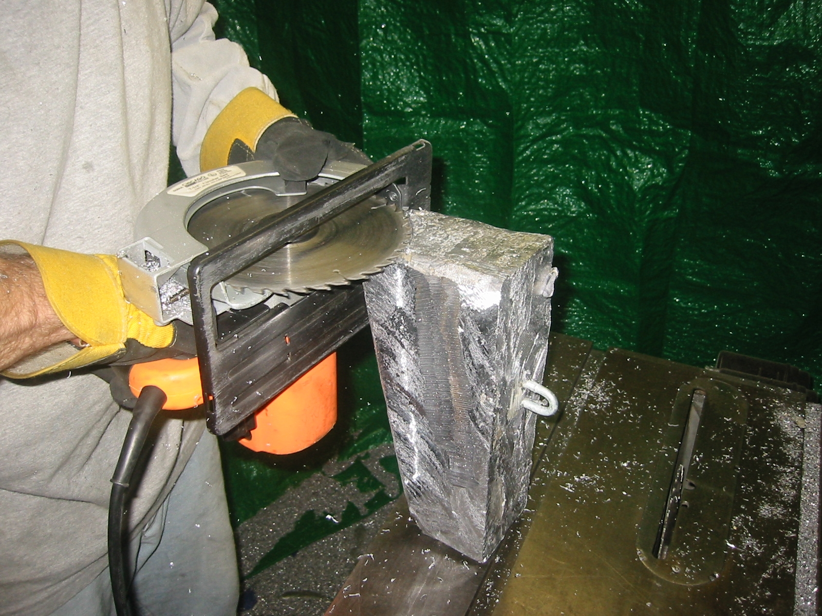 (4) We trimmed the lead blocks  with a skill saw using a carbide blade.  Tarps were hung to catch the chips.