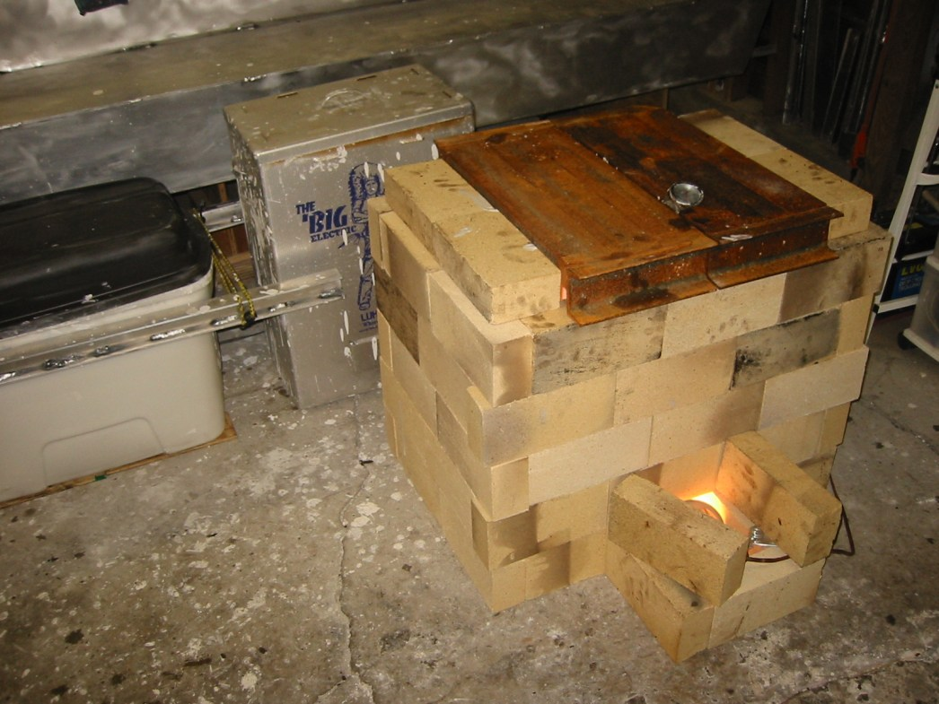 (5) Storage container of mud, meat smoker for drying small parts and a firebrick kiln for bigger parts.