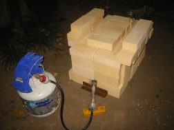 (2) Firing investment in a  temporary firebrick kiln.