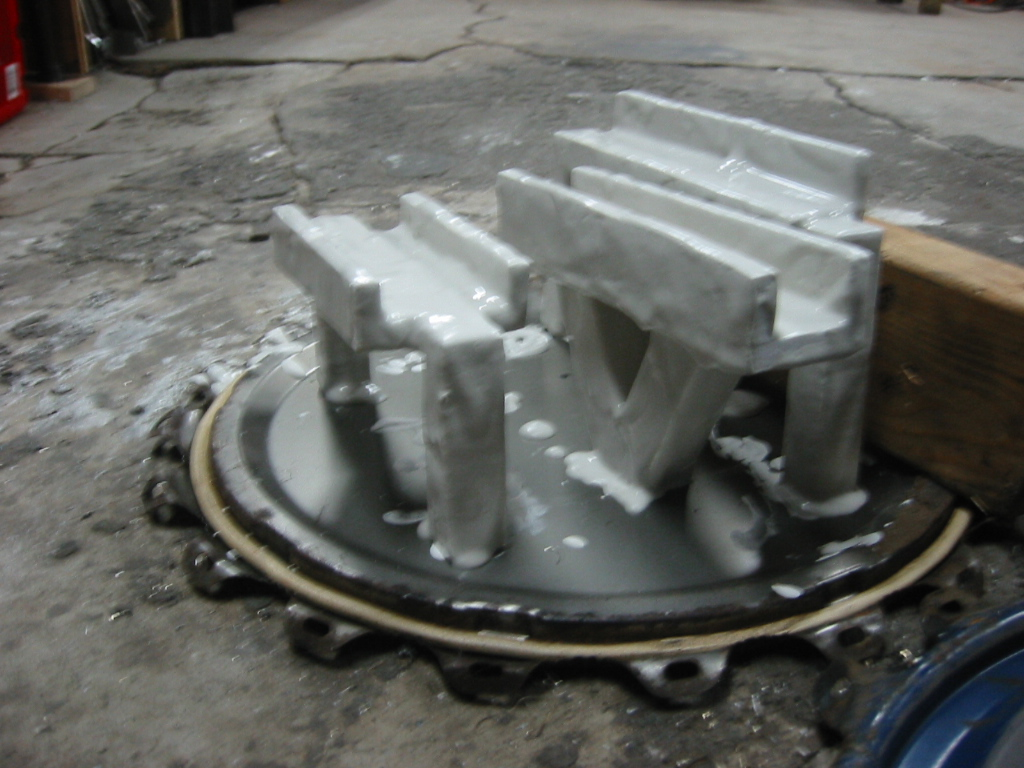 (2) Foam parts drying after being  coated with sheetrock mud.