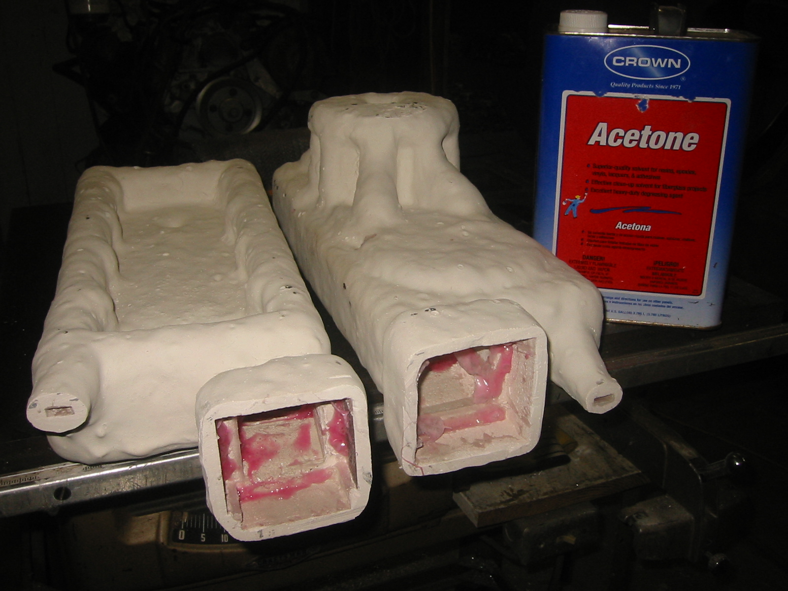 (6) When the investment is 1/4 to  3/8 inch thick the vents are cut open and the the foam is  dissolved with acetone.